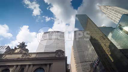 Chrysler and Met-Life Building and Grand Central Station Terminal - skyscrapers towering over Midtown - timelapse in Manhattan in 4K and 1080 HD in NYC