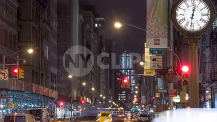 famous 5th Ave clock at night in Manhattan - traffic lights changing, timelapse pulling back in 4K and 1080 HD in NYC