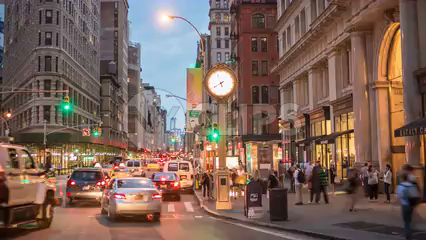 cars zooming past 5th Avenue clock at night - Manhattan traffic time-lase in 4K and 1080 HD in NYC