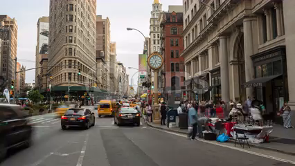 day turning into night on 5th Avenue with famous clock lighting up - timelapse in Manhattan in 4K and 1080 HD in NYC