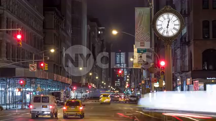 traffic lights changing red to green fast, timelapse of Fifth Ave clock in Manhattan at night in 4K and 1080 HD in NYC