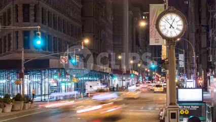 N and R subway train station with 5th Ave clock and cars speeding in timelapse of street at night in 4K and 1080 HD in NYC
