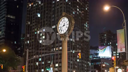 zooming out from famous 5th Ave clock in Flatiron - timelapse in Manhattan in 4K and 1080 HD in NYC