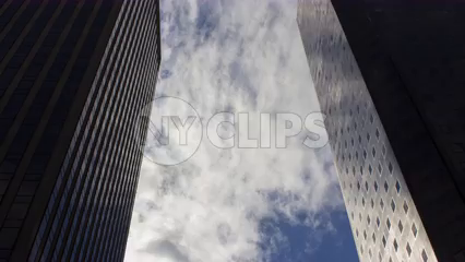 two corporate office buildings with 4K timelapse clouds in Manhattan NYC