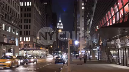The New School on Lower Fifth Avenue at night with Empire State Building view - zooming out slowly in timelapse of Manhattan in 4K and 1080 HD in NYC