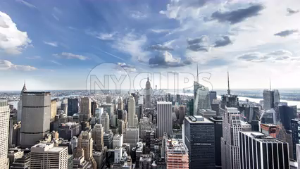 Manhattan cityscape from day to night in breathtaking timelapse with famous skyscrapers - Empire State Building in 4K and 1080 HD in NYC