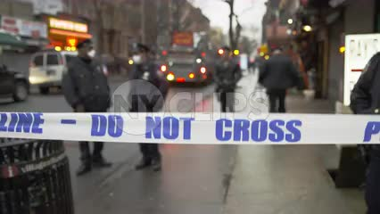NYPD crime scene tape, do not cross police line on Lower East Side of Manhattan in early evening on cold winter day in 4K and 1080 HD in NYC