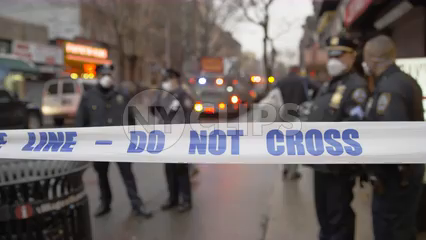 police line blocking crime scene - do not cross tape on Lower East Side in Manhattan 4K NYC