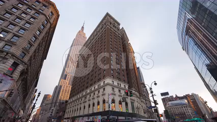 busy street view of Empire State Building from Herald Square with people and traffic during day - 4K time-lapse Manhattan