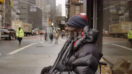 homeless man with oxygen tank and wheelchair on cold winter day begging for change on Manhattan street in 4K NYC