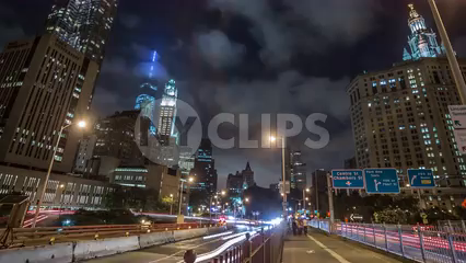 Downtown Manhattan at night coming off Brooklyn Bridge to FDR Drive - 4K timelapse in New York