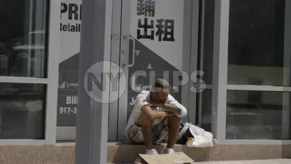 homeless caucasian man in shorts in the summer counting change on street in 4K New York City
