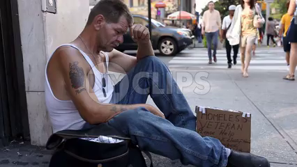 homeless veteran with r.i.p. mom tattoo sitting on sidewalk - man with sign in Union Square Manhattan New York City