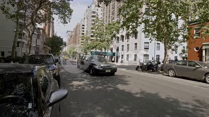 stretched black limousine driving down Lower 5th Avenue - 4K in Manhattan New York City