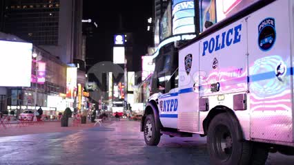 NYPD police truck parked in empty Times Square late at night in NYC