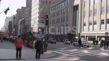 Empire State Building on 5th Ave on winter day with people walking, slow motion in NYC