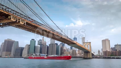 Brooklyn Bridge timelapse with Freedom Tower and Manhattan Skyline in background across East River - 4K in New York City