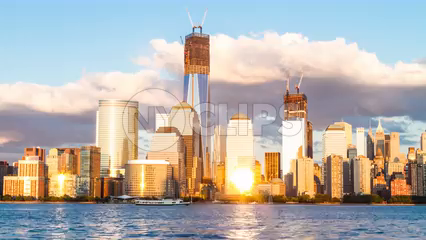 Downtown Manhattan skyline with Freedom Tower under construction - 4K timelapse from day to night in NYC