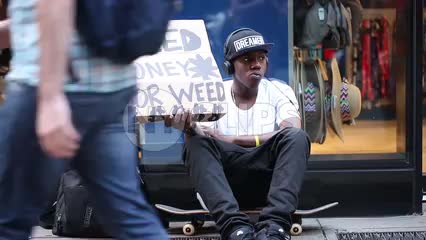 homeless kid with funny sign begging for money to buy weed - skater with backpack - traveler with headphones on drugs in NYC
