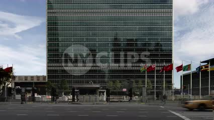 taxicab driving past United Nations building in traffic on 1st Ave in Manhattan NYC
