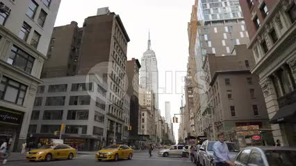 Empire State building Street view from lower Fifth Avenue daytime in 4K and 1080 HD in NYC
