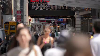 crowded Midtown with people walking in slow motion near Times Square on sunny day in 1080 HD NYC