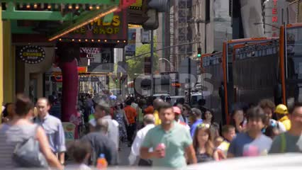 foot traffic in Times Square, crowded street with people walking in busy Manhattan in NYC