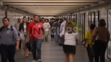subway corridor - people walking in tunnel in slow motion - summer in NYC