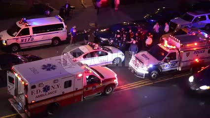 crime scene - NYPD police cars and FDNY ambulance with flashing lights at night in NYC