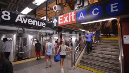 crowded subway platform and stairs with people exiting train - commuting on 8th ave in 1080 HD NYC