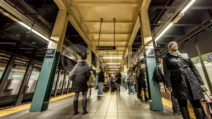 42nd Street platform people rushing to catch subway train - HDR timelapse in 4K and 1080 HD NYC