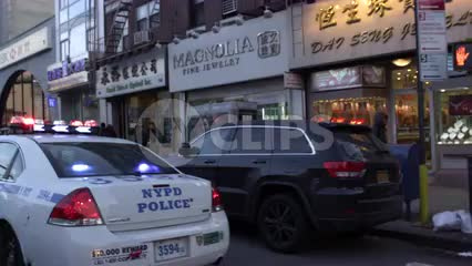 police car in Chinatown - driving past NYPD cops double parked with flashing lights in slow motion 4K and 1080 HD in NYC