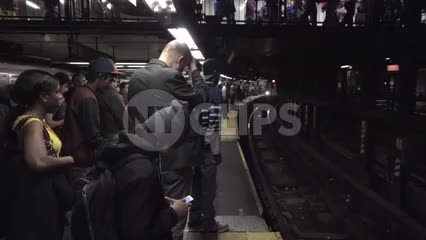 4 train pulling into subway station with crowd of passengers waiting on platform, 1080 HD in NYC