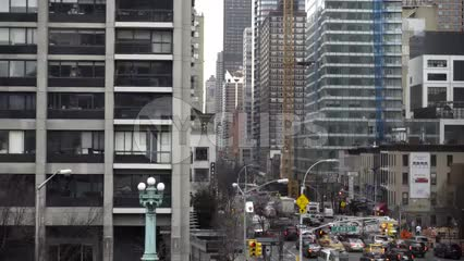 buildings on East Side of Manhattan moving overhead with busy street below in 1080 HD in NYC