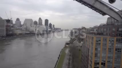 crossing East River from high aerial tram view over water in 1080 HD in NYC