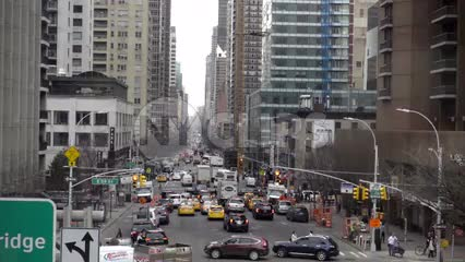 Ed Koch Queensboro Bridge sign moving overhead tram over busy street with cars in traffic in Manhattan 1080 HD in NYC