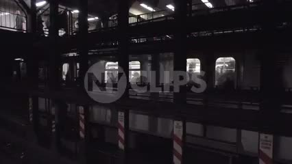 express train on middle track passing the station, people are waiting for local service on subway platform in 1080 HD in NYC