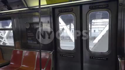 elevated subway train interior, panning across empty seats inside carriage in 1080 HD in NYC