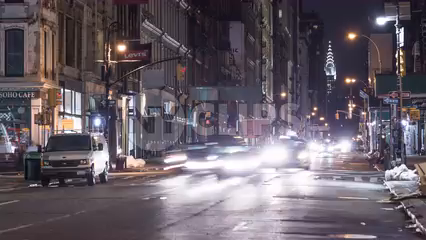 Chrysler Building from Broadway with taxis zooming in SoHo Downtown Manhattan - 4k timelapse NYC