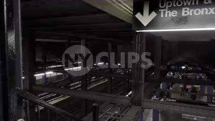 panning across sign for Uptown and The Bronx in subway station at 14th Street in 4K and 1080 HD in NYC