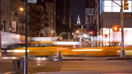 Chrysler Building view from SoHo on busy intersection of Broadway and Houston St in Manhattan - 4k timelapse NYC