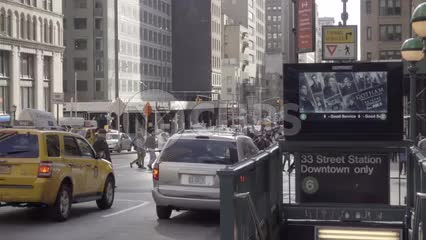 33rd Street downtown subway station entrance, people crossing street in slow motion in 1080 HD in NYC