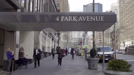 4 Park Ave entrance on street, people walking in winter fall or spring with coats in NYC