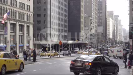 cars driving in traffic on Park Ave during day in winter, 1080 HD in NYC