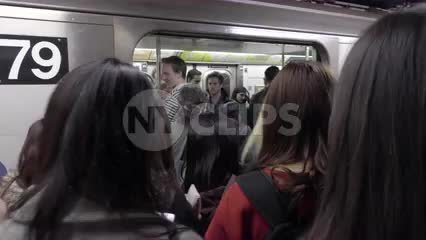 crowded subway platform, passengers entering carriage at rush hour in 4K and 1080 HD in NYC