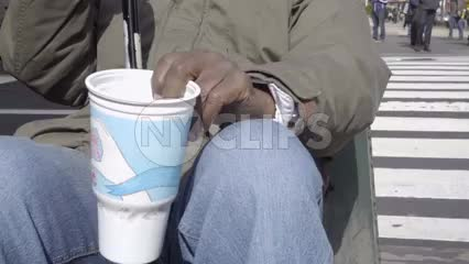 homeless old man shaking cup on Park Avenue begging for change in slow motion 1080 HD in NYC