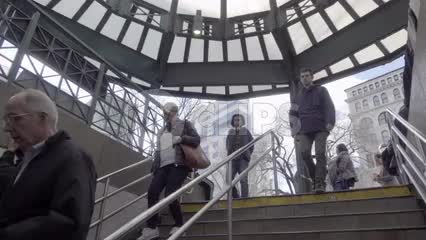 people walking downstairs at Union Square subway station entrance on winter day in slow motion 1080 HD in NYC