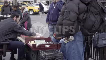 racial diversity in Union Square Park, chess matches at tables in slow motion NYC