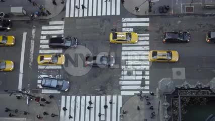 view from tall building downward angle in Midtown Manhattan busy intersection in 4K and 1080 HD in NYC