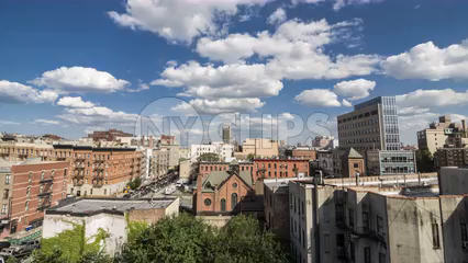 timelapse of Harlem during day - 4K from rooftop overlooking Uptown Manhattan neighborhood church in New York City